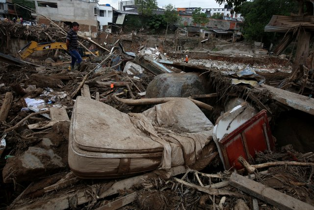 A man looks at a destroyed area, after flooding and mudslides caused by heavy rains leading several rivers to overflow, pushing sediment and rocks into buildings and roads, in Mocoa, Colombia April 2, 2017. Picture taken April 2, 2017. REUTERS/Jaime Saldarriaga
