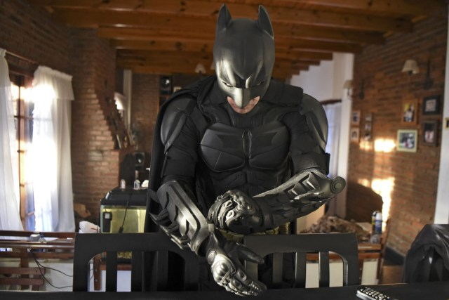 Argentine Batman, gets dressed in his house in La Plata, 60 kilometres south of Buenos Aires, on June 2, 2017.  The Argentine Batman has made La Plata children's hospital a target of laughter and treats against pain. / AFP PHOTO / Eitan ABRAMOVICH