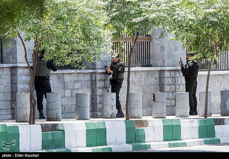 Members of Iranian forces run for cover during an attack on the Iranian parliament in central Tehran, Iran, June 7, 2017. Tasnim News Agency/Handout via REUTERS ATTENTION EDITORS - THIS PICTURE WAS PROVIDED BY A THIRD PARTY. FOR EDITORIAL USE ONLY. NO RESALES. NO ARCHIVE.