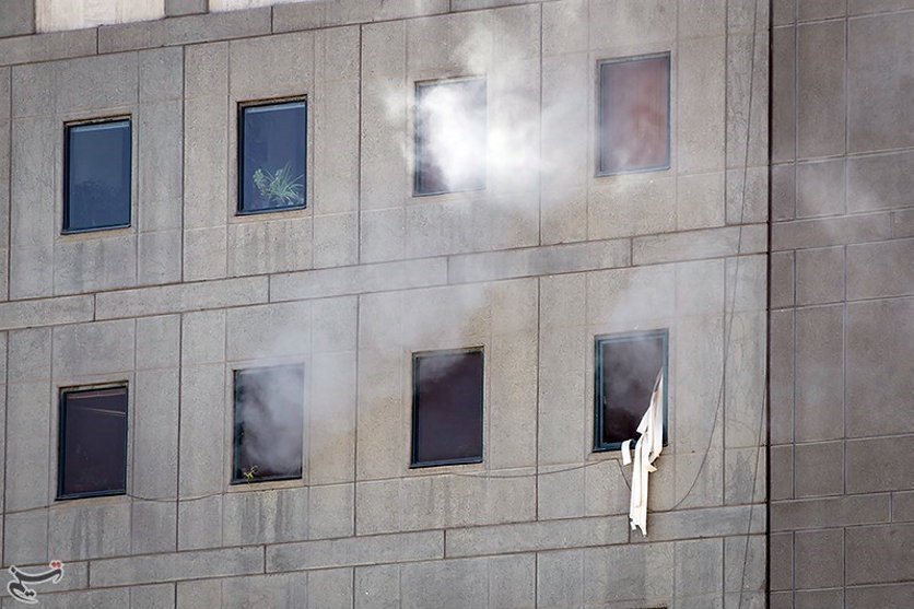 Smoke is seen during an attack on the Iranian parliament in central Tehran, Iran, June 7, 2017. Tasnim News Agency/Handout via REUTERS ATTENTION EDITORS - THIS PICTURE WAS PROVIDED BY A THIRD PARTY. FOR EDITORIAL USE ONLY. NO RESALES. NO ARCHIVE.
