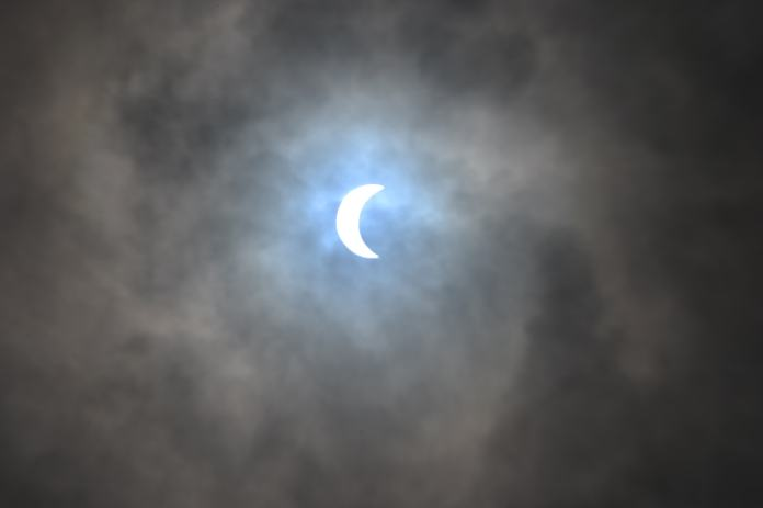 "The total solar eclipse is viewd from Charleston, South Carolina, on August 21, 2017. The Sun started to vanish behind the Moon as the partial phase of the so-called Great American Eclipse began Monday, with millions of eager sky-gazers soon to witness ""totality"" across the nation for the first time in nearly a century. / AFP PHOTO / MANDEL NGAN"