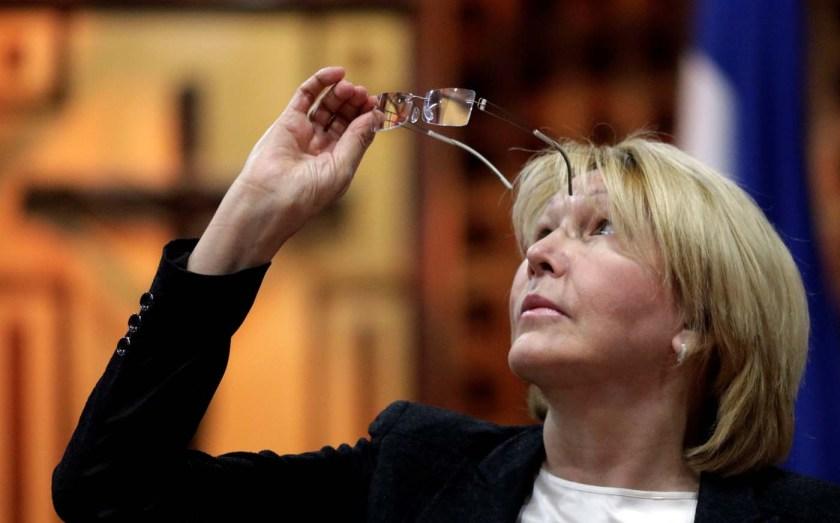 Venezuela's chief prosecutor Luisa Ortega Diaz looks at her glasses during a meeting in defense of the Constitution in Caracas, Venezuela August 6, 2017. REUTERS/Ueslei Marcelino