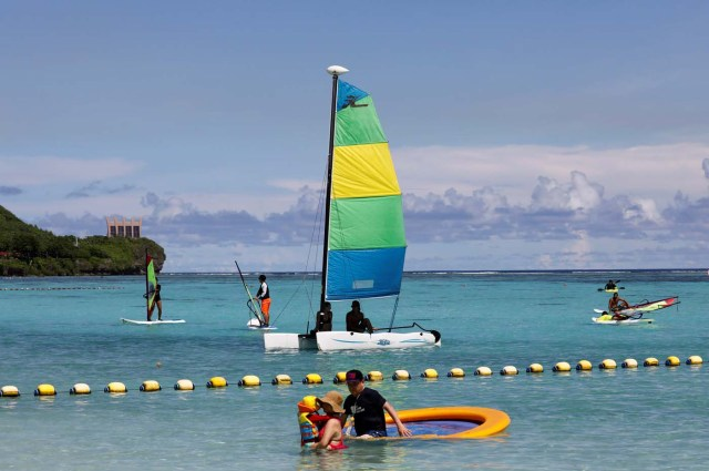 Tourists are pictured on the waters off Tumon beach on the island of Guam, a U.S. Pacific Territory, August 11, 2017. REUTERS/Erik De Castro