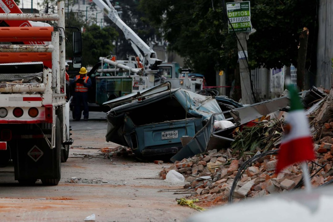 A damaged wall and a smashed vehicle are pictured after an earthquake in Mexico City, Mexico September 8, 2017. REUTERS/Carlos Jasso