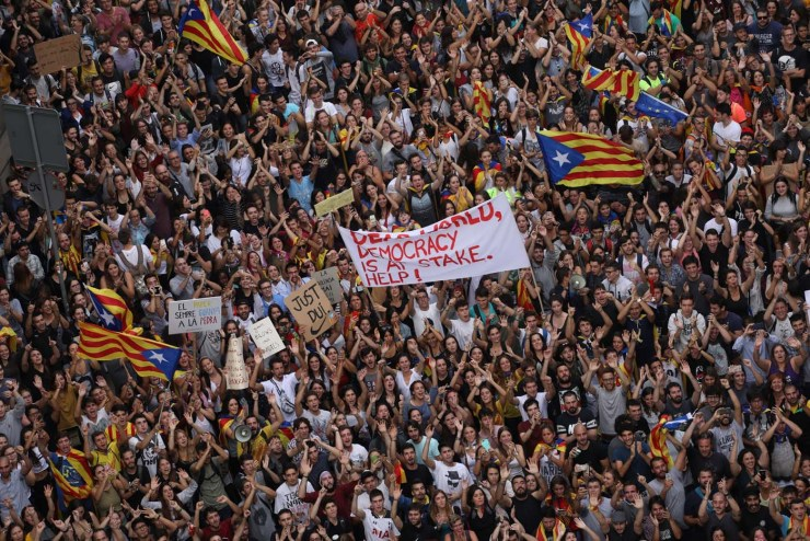 People shout during a protest outside National Police main police station, in Barcelona, Spain October 3, 2017. REUTERS/Susana Vera