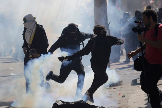Demonstrators clash with police during a protest against the 2014 World Cup in Sao Paulo