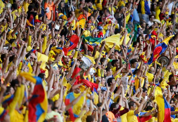 Colombian fans celebrate their team's third goal against Greece during the 2014 World Cup Group C soccer match at the Mineirao stadium in Belo Horizonte
