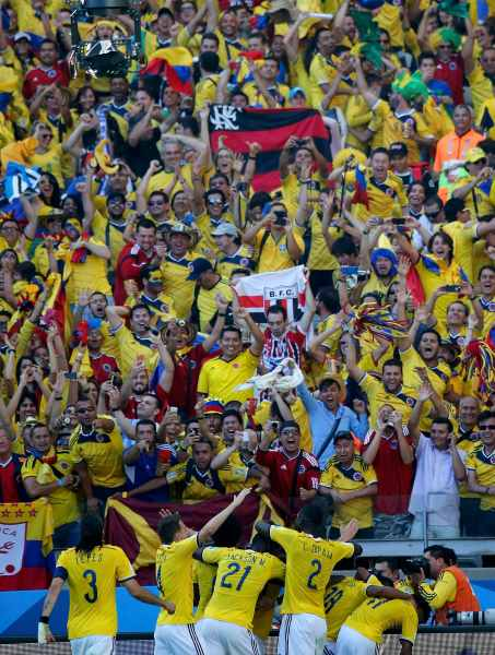 Colombia's players celebrate after James Rodriguez scored a goal against Greece during their 2014 World Cup Group C soccer match at the Mineirao stadium in Belo Horizonte