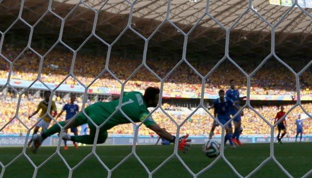 Greece's goalkeeper Orestis Karnezis fails to save the ball during 2014 World Cup soccer match between Colombia and Greece in Belo Horizonte
