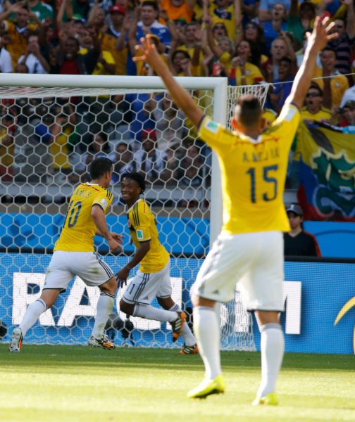 Colombia's James Rodriguez, Colombia's Juan Cuadrado and Colombia's Alexander Mejia celebrate after Colombia's third goal during their 2014 World Cup Group C soccer match at the Mineirao stadium in Belo Horizonte