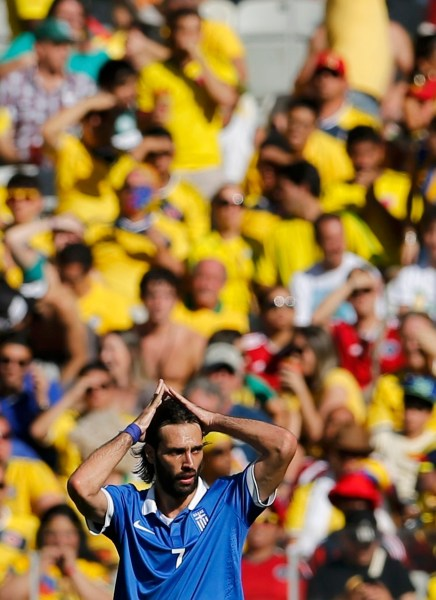 Greece's Giorgios Samaras react after Colombia's Gutierrez scored during 2014 World Cup soccer match in Belo Horizonte