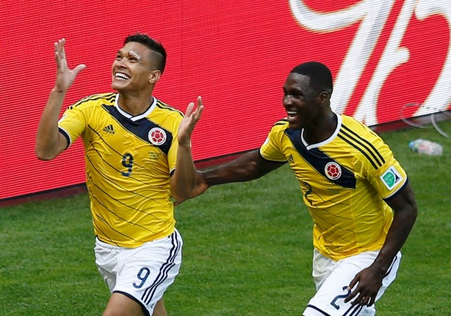 Colombia's Gutierrez celebrates with teammate Zapata after scoring against Greece during their 2014 World Cup Group C soccer match at the Mineirao stadium in Belo Horizonte