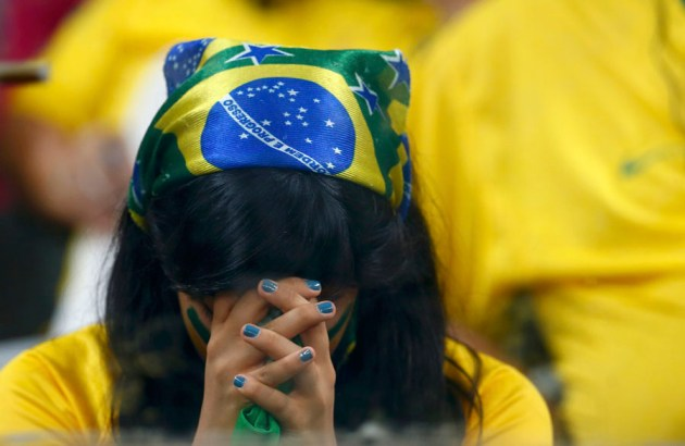 A Brazil fan reacts during the 2014 World Cup semi-finals between Brazil and Germany at the Mineirao stadium