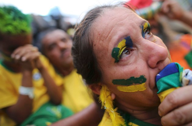 A Brazilian soccer fan cries as she watches the 2014 World Cup semi- final soccer match between Brazil and Germany in Sao Paulo