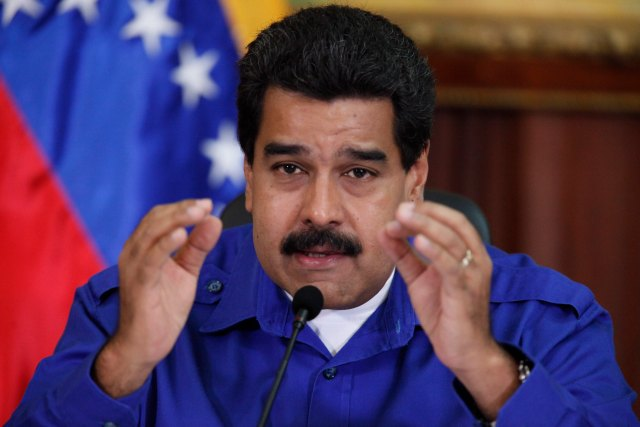 Venezuela's President Nicolas Maduro talks during a meeting with ministers at Miraflores Palace in Caracas