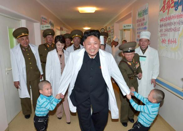 File photo shows North Korean leader Kim Jong un playing with children during a visit to the Taesongsan General Hospital in this undated photo released by North Korea's KCNA agency in Pyongyang