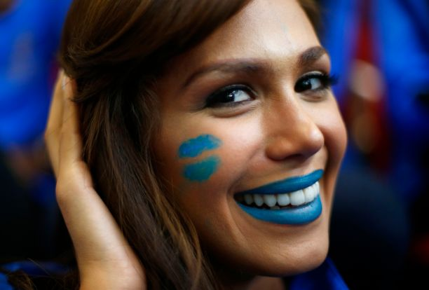 Miss Venezuela Debora Menicucci wears face paint during the Miss World sports competition at the Lee Valley sports complex in north London