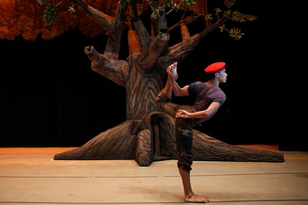 """Lobo, 29, performing as Venezuela's late president Hugo Chavez, stretches before the """"Ballet of the Spider-Seller to Liberator"""" at Teresa Carreno theater in Caracas"""