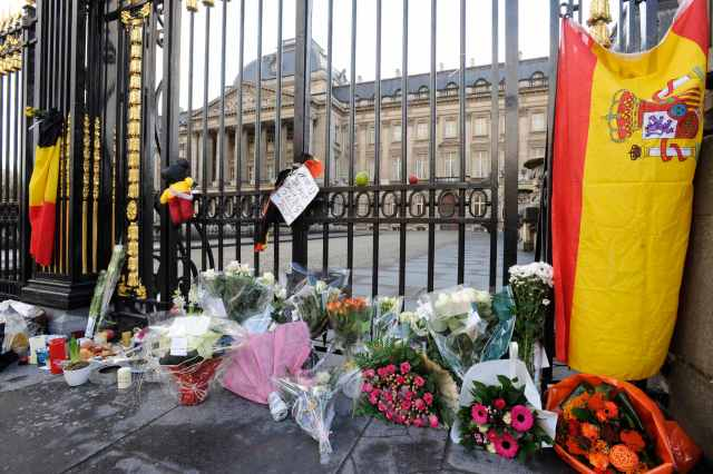 Spanish and Belgian flags are placed with flowers outside the Royal Palace in honour of Queen Fabiola in Brussels
