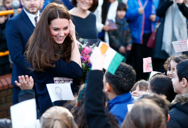 Britain's Catherine, Duchess of Cambridge speaks to school children as she leaves after visiting the Clore Art Room in west London