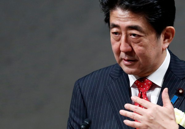 Japan's Prime Minister Abe speaks during a year end meeting at Japan Business Federation in Tokyo