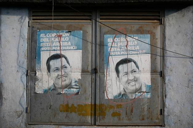 Posters with pictures of Venezuela's late President Hugo Chavez are seen on doors in Caracas