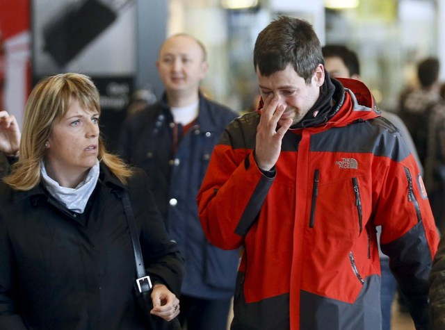 A family member of a passenger feared killed in Germanwings plane crash reacts as he arrives at Barcelona's El Prat airport