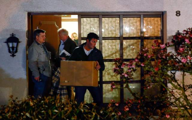 German police officers carry boxes out of a house believed to belong to the parents of crashed Germanwings flight 4U 9524 co-pilot Andreas Lubitz in Montabaur