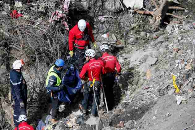 French rescue workers inspect the remains of the Germanwings Airbus A320 at the site of the crash