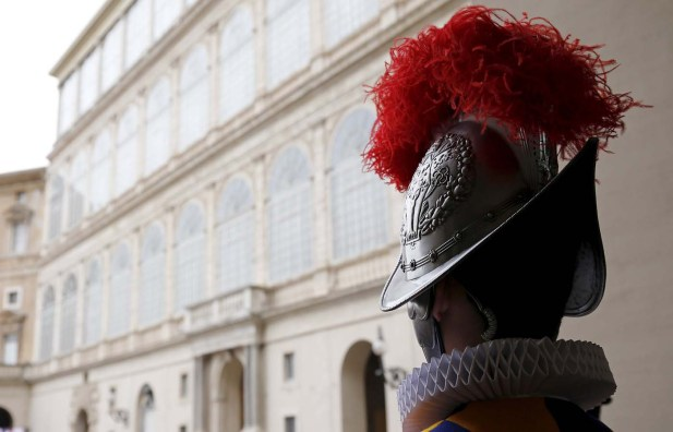 A new recruit of the Vatican's elite Swiss Guard stands at attention during the swearing-in ceremony at the Vatican
