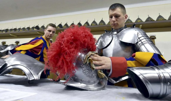 New Vatican Swiss guards polish their uniforms prior to a swearing-in ceremony at the Vatican