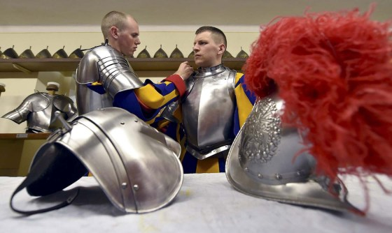 New Vatican Swiss Guards adjust their uniforms prior to a swearing-in ceremony at the Vatican