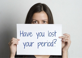 Women holding a sign. Have you lost your period?