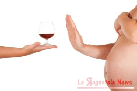 Pregnant woman rejects of taking glass of brandy.