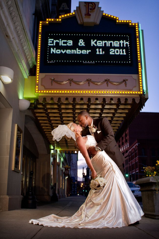 bride and groom portrait in front of the Palace Theater in Waterbury