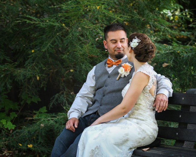 Bride and groom on bench at Litchfield wedding