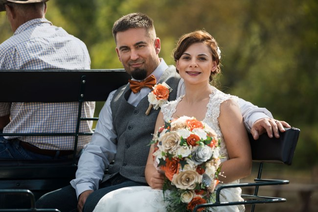 Couple taking a ride in the horse and carriage after their Litchfield wedding ceremony