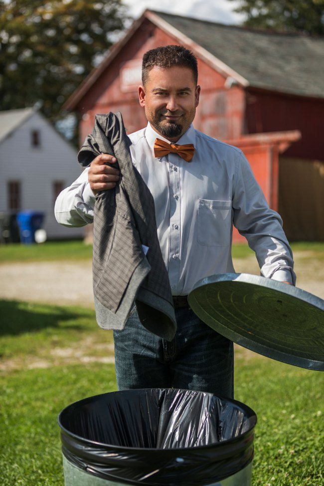 Groom throws away vest at casual Bunnell Farm wedding in Litchfield