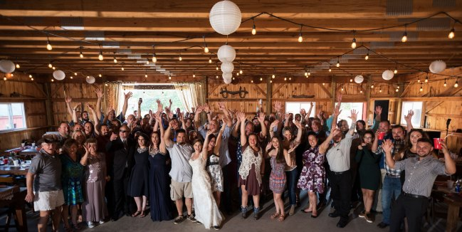 Large group photo at barn wedding at Bunnell Farm in Litchfield