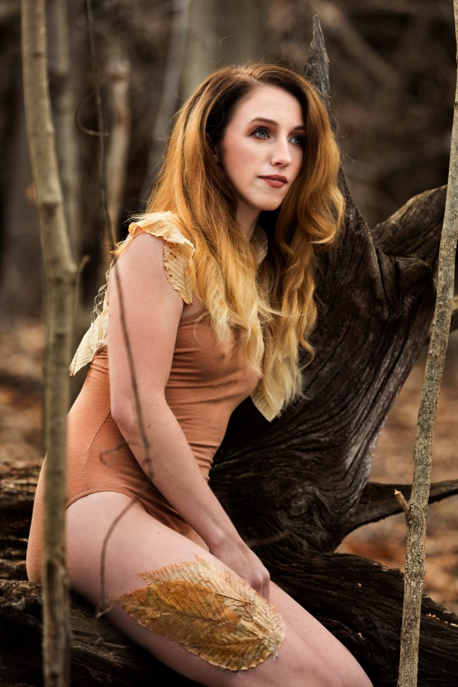woman in forest in leotard