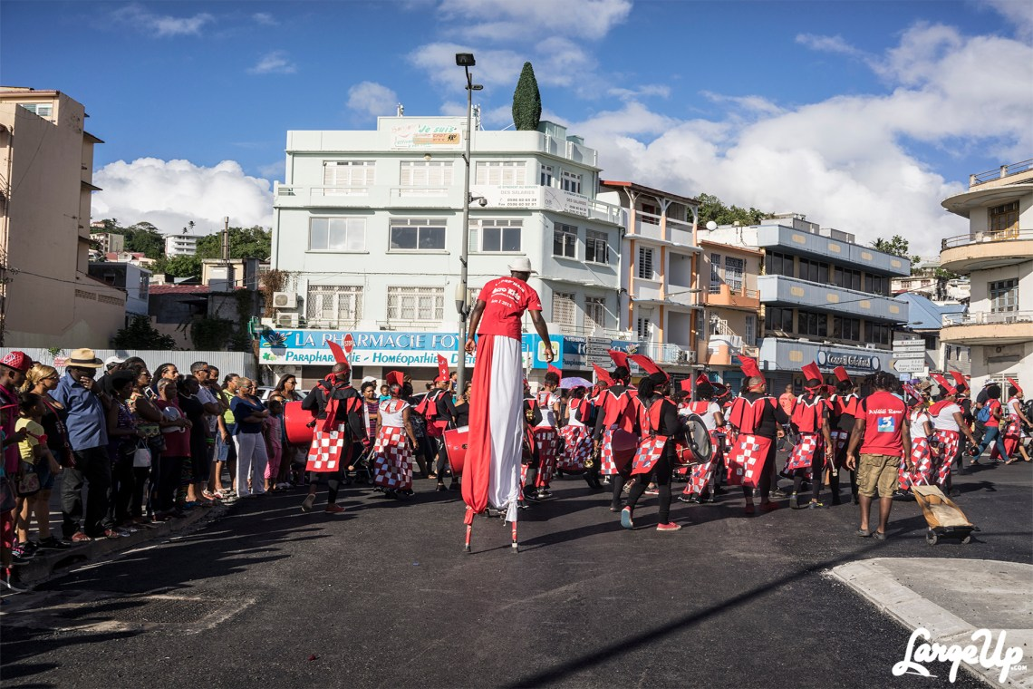 Man on stilts at the Foyal Parade in Centre Ville, Fort-de-France, Martinique photo by Adama Delphine Fawundu