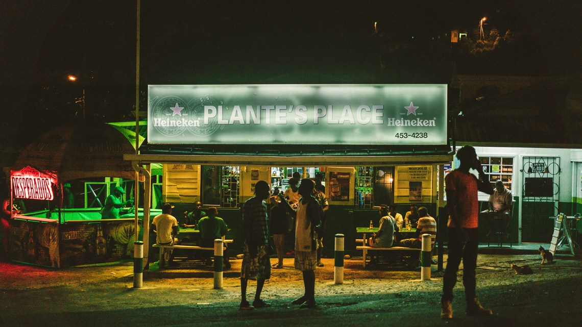 Patrons outside Plante's Place, a popular local bar in Dennery, St. Lucia