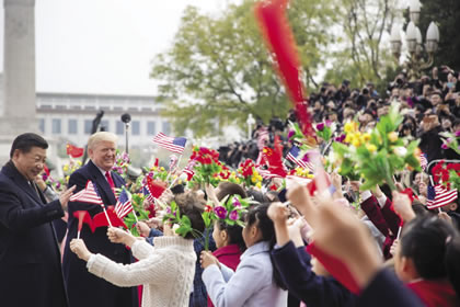 White House/Andrea Hanks President Xi (left) and President Trump being greeted Nov. 10 during his visit to China.