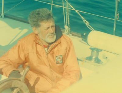 Loren Edwards at the helm of his beloved Spellbound, 1977