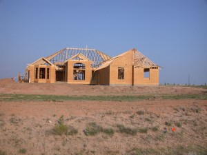 New Home for Harry & Madeline in Dalhart TX being framed 2002.