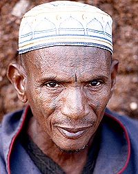 The old scarmaster N'dah Yerime uses tools that were passed down to him from his grandfather who was also a renowned skin artist.  The tools of the older generation are more oval than the ones that M'Batinin uses (right) and N'dah Yerime swears that blacksmiths today could never replicate those made in his grandfather's generation.