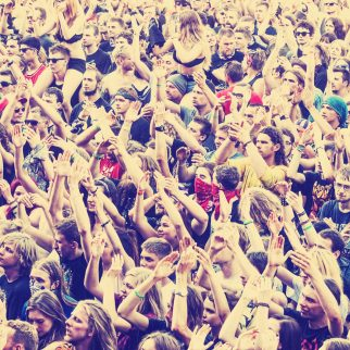 People applauding concert.