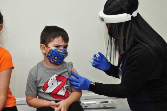 Aiden Cruz 4 receives a vaccination from LaSalle Medical Associates Nurse Megan