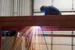 Contractor Supporting Services: Welder working steel structure Hangar