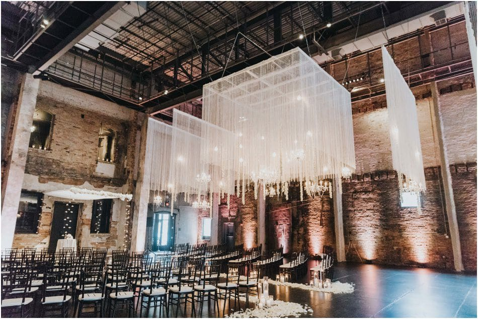 Aria Wedding in Minneapolis, MN with hanging chandeliers and flowers